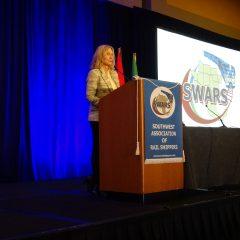 Treasurer Gail Molek introduces the SWARS TripBuilder meeting APP