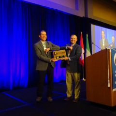 Incoming President Ray Hufnagel presents outgoing President Dale Diulus with a Thank You Plaque